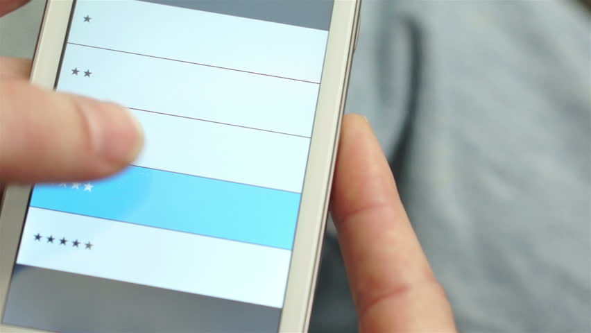 Anonymous man taking a quality of service survey on his mobile phone or device.   Shutterstock HD Video #8359237