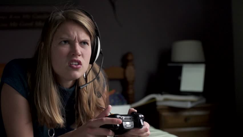 A woman is very angry and confused while playing a game in slow motion.