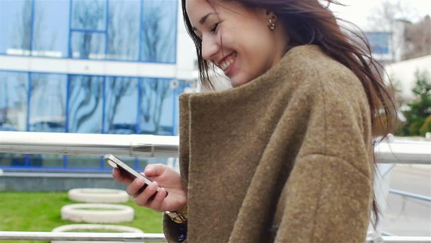 Young beautiful business woman using smartphone....