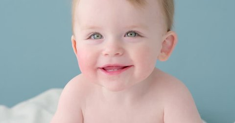 Happy baby smiling gorgeous close up slow motion