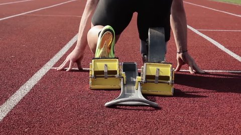 Athlete with handicap starts out of the blocks.