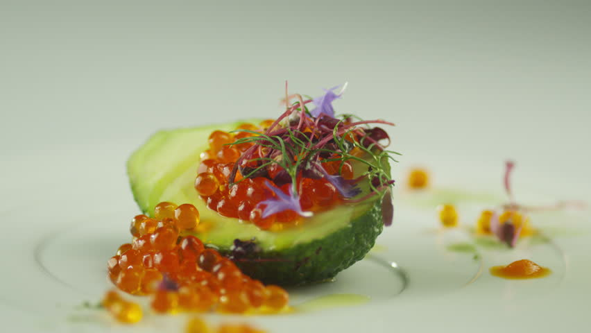 Garnish Red Salmon Caviar with Avocado and Olive Oil in Luxury Restaurant Shot on RED Cinema Camera in 4K (UHD). ProRes codec - Great for editing, color correction and grading.