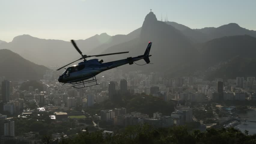 Sugarloaf Helicopter taking off with Christ Redeemer Statue in Background  Location: Sugarloaf - Rio de Janeiro  Source: 5D Mark III  Original File
