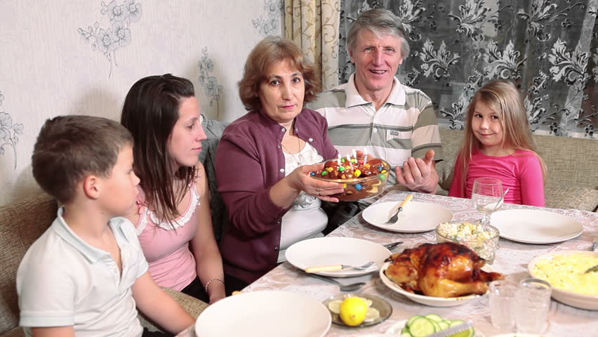Grandfather Blowing Candles On Birthday Cake Sitting With Big Family At Dinner  Table Stock Footage Video 8522947 | Shutterstock