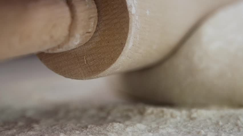Rolling dough with rolling pin for baking, SLOW MOTION