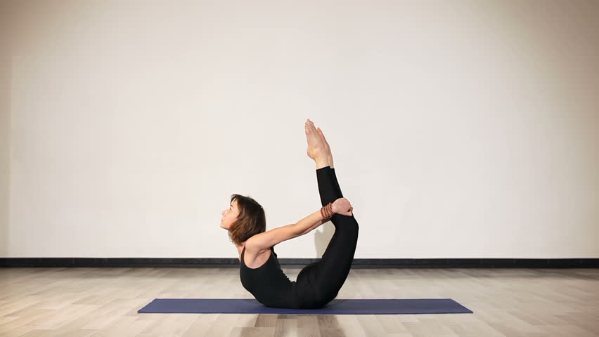 Female In Black Clothes Doing Headstand Splits In Yoga