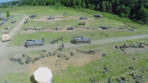NELIDOVO - JUL 12, 2014: Explosions in trenches of German force during reconstruction Battlefield at summer day. Aerial view