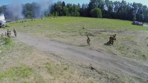 NELIDOVO - JUL 12, 2014: Assault of Red army with tanks during reconstruction Battlefield at summer day. Aerial view
