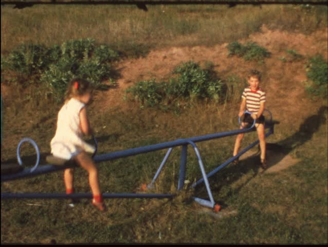 Children on seesaw (vintage 8 mm amateur film)