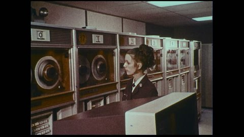 UNITED STATES 1970s :An officer observes computers as they record and store information.
