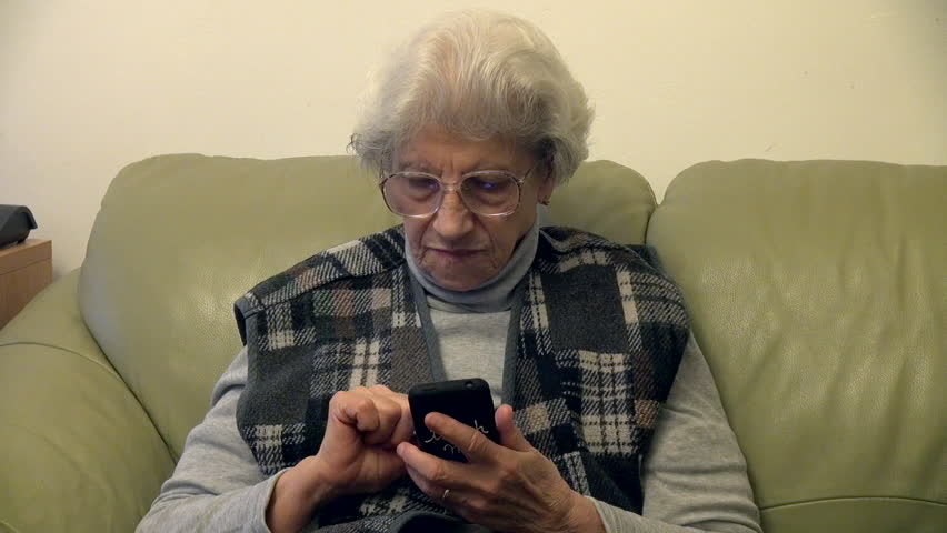 80 years old woman using smart phone, cellphone, grandma, reflection in eyeglasses | Shutterstock HD Video #8699677
