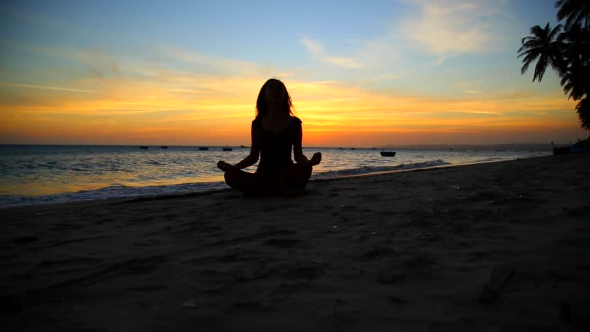 Young Practicing Yoga By The Sea At Sunset Hd Stock Footage Clip