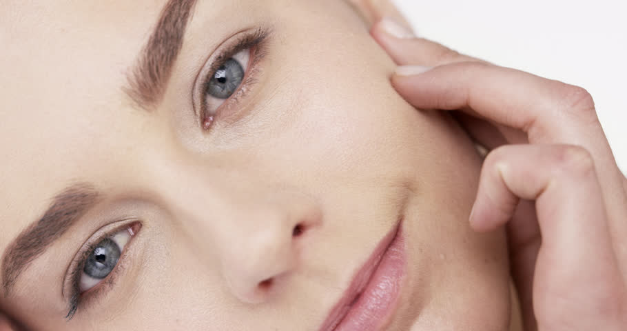 Closeup portrait of beautiful woman resting head slow motion skincare concept - Red Epic Dragon