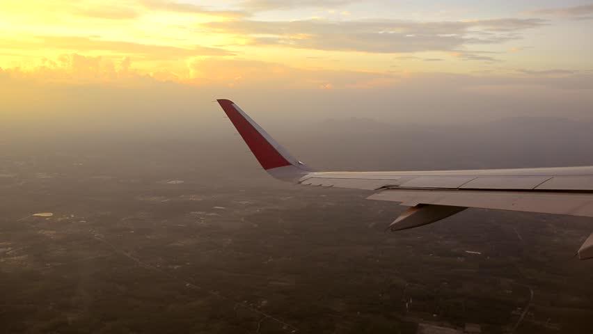 Plane wing window sky sunset | Shutterstock HD Video #8831578