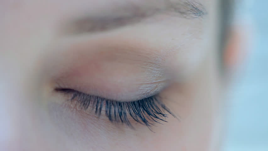 Close up detail view of a young caucasian woman eye looking at the camera and blinking slowly. Eyes and vision well being and healthy eye sight. Attractive woman with blue green eyes. | Shutterstock HD Video #8839027