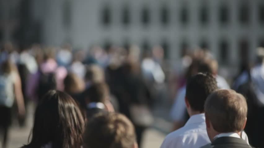 Hi-mo large crowd of pedestrians walk over London Bridge 03 | Shutterstock HD Video #8846296