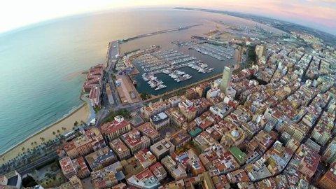 The port of Alicante with Sea Mediterranean, beach, sun, port, Spain, Alicante, Alacant. 4k UHD high altitude footage