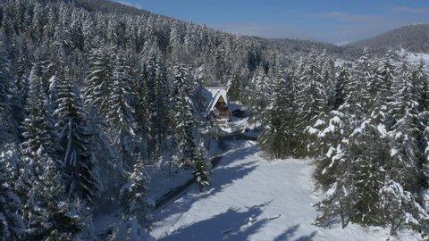 Aerial - Cottage village near the frozen lake