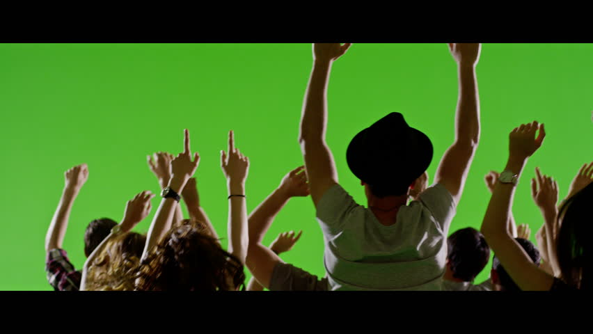 4K Crowd of fans dancing on green screen. Concert, jumping, Dancing, photo shooting, Slow motion.  Shot on RED EPIC Cinema Camera.