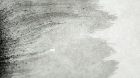 Ink On Parchment Paper. Slow Motion black in reacting to parchment paper and water. Fantastic for titles and transitions.