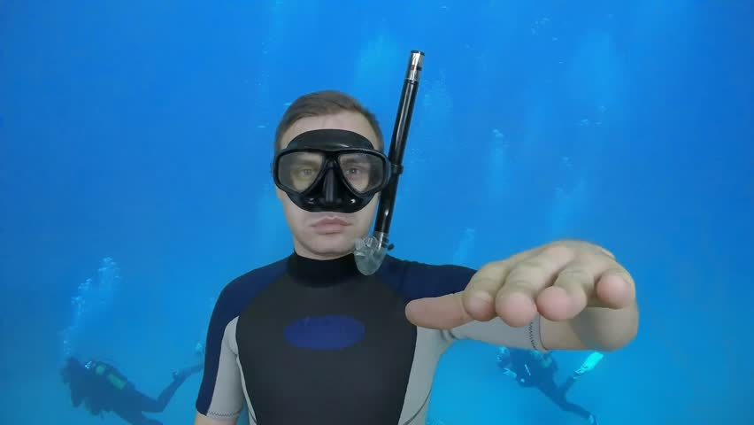 Dive sign -SOMETHING WRONG divemaster shows a basic sign from diving course, 2 of 10(open water diver) also a available on the green screen all of diving signs from course | Shutterstock HD Video #8900827