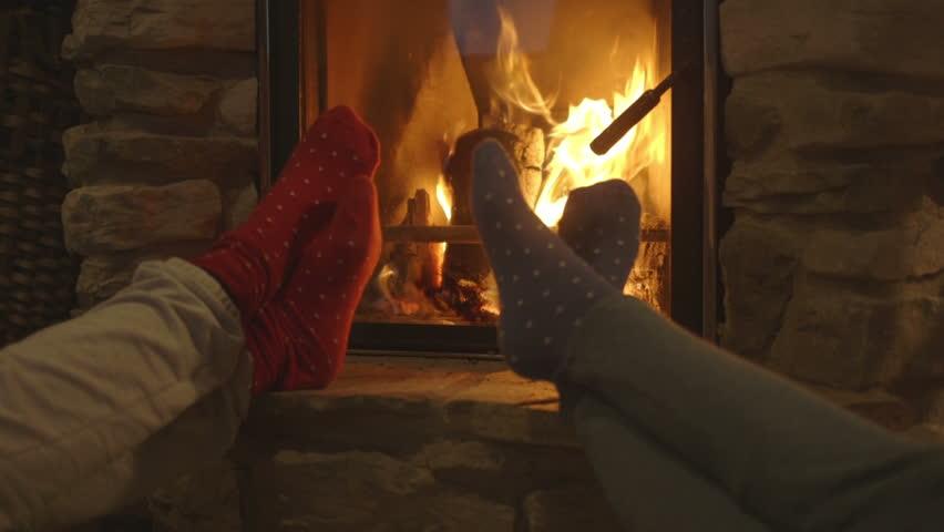 Young women relaxing beside fireplace | Shutterstock HD Video #8904397