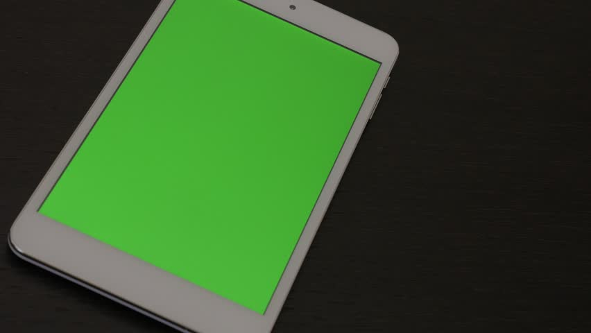 Green screen on tablet PC while panning 4K 2160p UHD footage - Greenscreen display on PC tablet close-up 4K 2160p UHD video #8915437