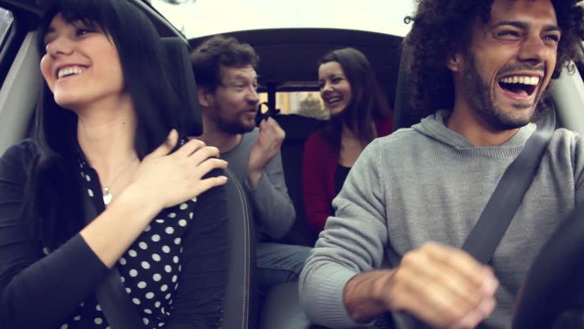 Four happy cool people having fun in car   Shutterstock HD Video #8926981