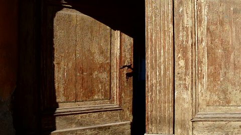 """An old wooden door is closing slowly. Can be used as a metaphor for hint an ending of something""""( era, chapter, story, ideas, facts, phenomena, etc). """"A new door is open, another is closing..."""""""
