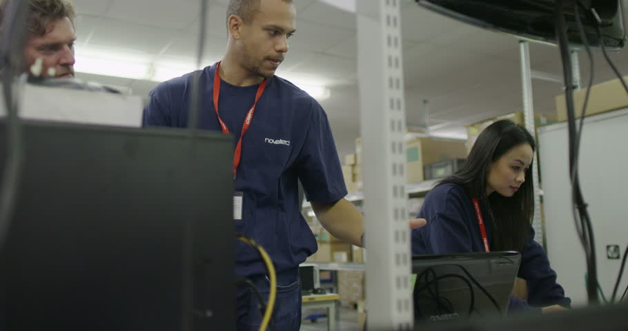 4K Team of workers in an electronics factory working on computer testing and repair | Shutterstock HD Video #8938687