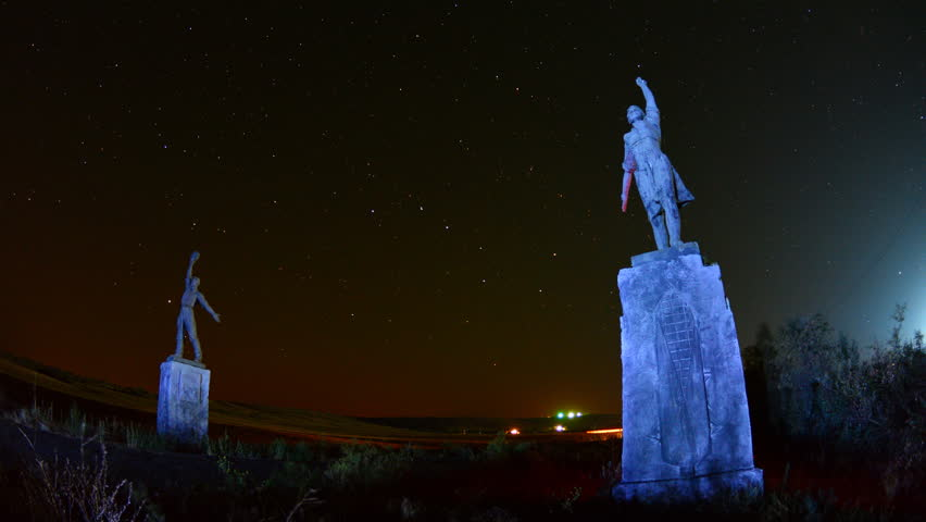 Old monuments boy and girl on night moving stars background time lapse
