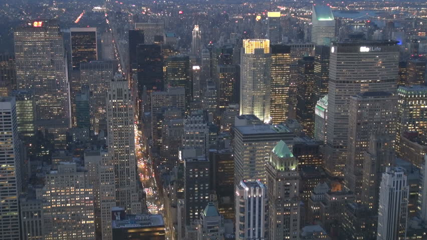 NEW YORK, APRIL 21, 2013, Aerial view of modern skyscraper with traffic street on busy avenue in twilight | Shutterstock HD Video #8979286