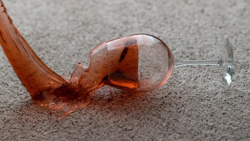 Glass of red wine spilling on carpet in slow motion; shot on Phantom Flex 4K at 1000 fps