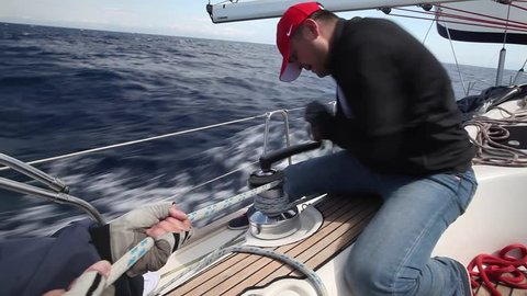 PELOPONNESE, GREECE - CIRCA OCT, 2014: Clips set: Sailors participate in sailing regatta 12th Ellada Autumn 2014 among Greek island group in the Ionian Sea and Aegean Sea, in Cyclades and Saronic Gulf