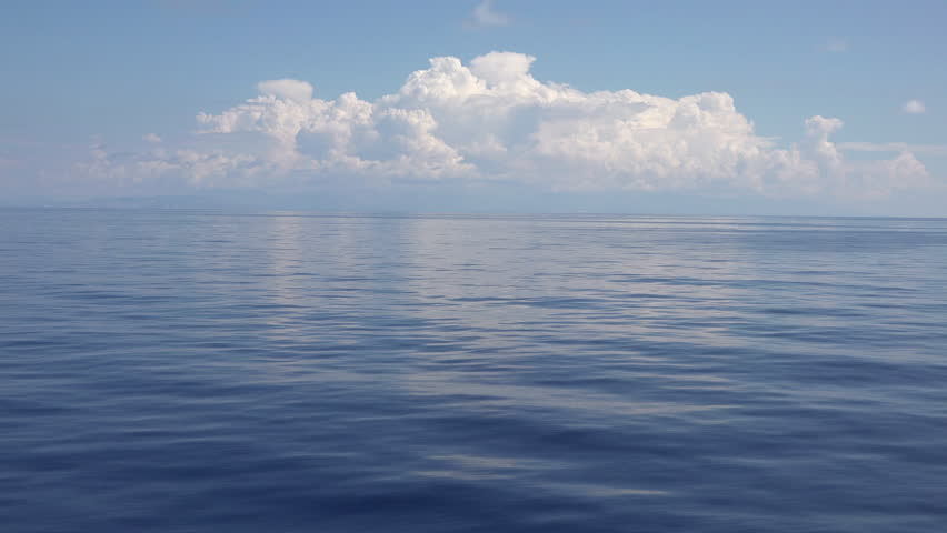Mediterranean Ocean blue water storm clouds. Beautiful Mediterranean Ocean waves with horizon in distance. Cruise ship vacation in Europe. Environmental and nature with deep blue sea. | Shutterstock HD Video #9005587