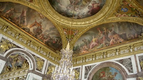 VERSAILLES, FRANCE - CIRCA 2014: The Peace Salon - roof decorations - located at the southern end of the Hall of Mirrors (opposite to the War Salon)