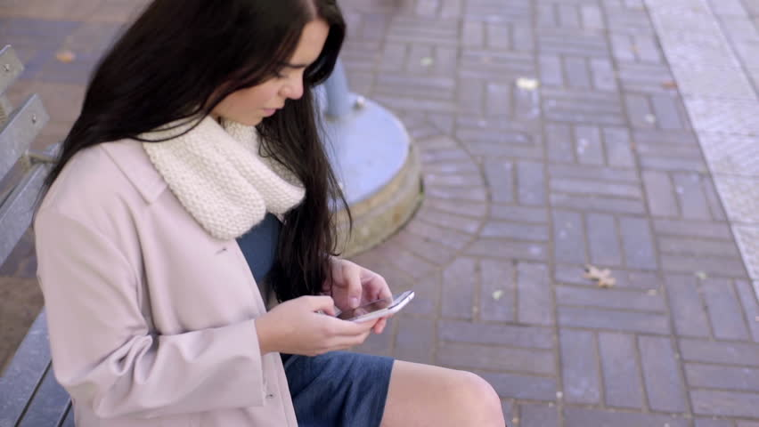 Mixed Race Young Woman Uses Her Smart Phone On A City Bench | Shutterstock HD Video #9035716