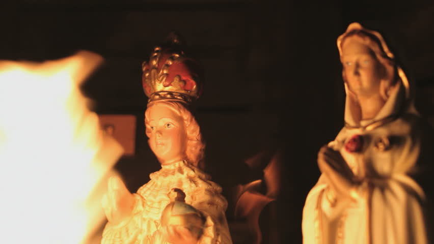 Ave Maria Statue with burning flames