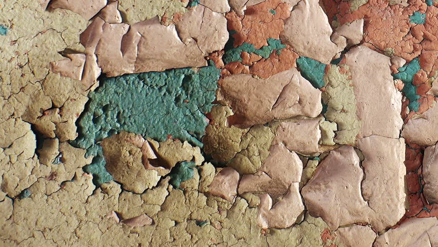 Shabby paint on the wall.