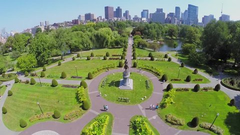 BOSTON - SEP 05, 2014: People walk by Boston Public Garden near George Washington Equestrian Statue at autumn sunny day. Aerial view. Public Garden total area is about 97000 sq.m.