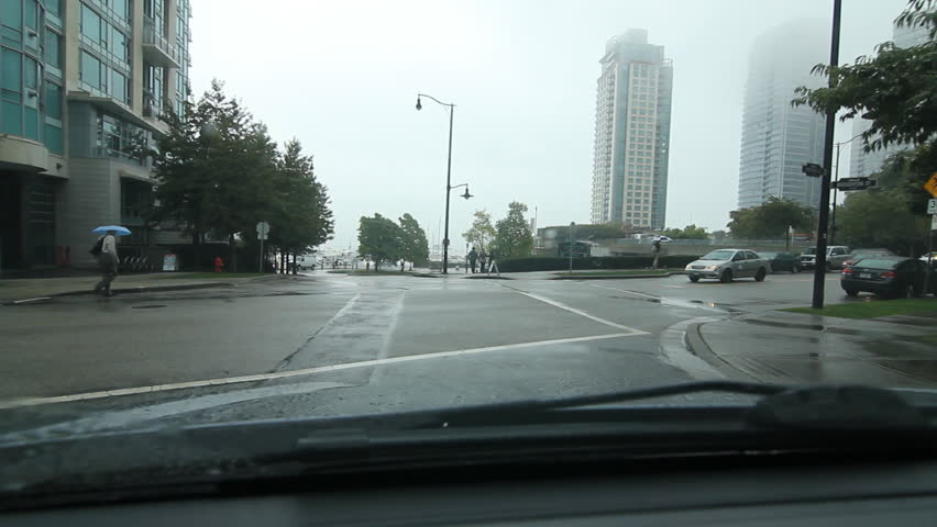 VANCOUVER, CANADA on SEPT 19th: Driving on a rainy day in Vancouver, Canada on Sept 19th, 2014. Driving east on W Hastings Street on rainy day in downtown Vancouver, BC. | Shutterstock HD Video #9087137