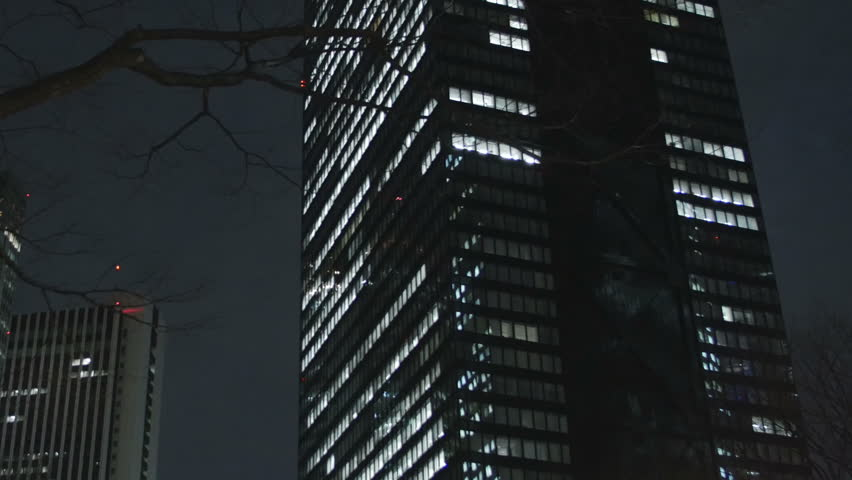 Zooming out of buildings with late working employees at Shinjuku skyscrapers. | Shutterstock HD Video #9112277