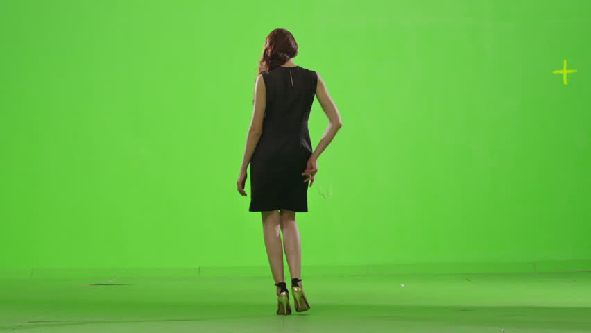 Model walks. Fashion model from behind on green screen. Slow motion. Shot on RED EPIC Cinema Camera.