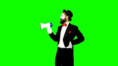 Funny, bearded, young man mime using white speaker and trying to fix it on green screen