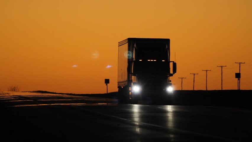 Oncoming truck with headlights at dusk. Saskatchewan, Canada.