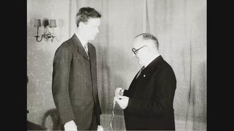 CIRCA 1930s - The French ambassador to the United States gives Col. Lindberg a medal of honor in 1931