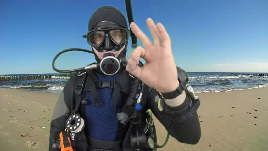 Dive instructor shows sing : OK  also a available on the green screen all of diving sings from course with full dive gear (open water diver) all background from movies separately in portfolio. 7/16 | Shutterstock HD Video #9196457