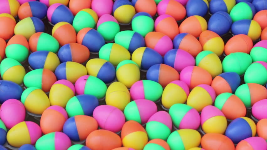 Colorful plastic eggs toys floating on the water background | Shutterstock HD Video #9199127