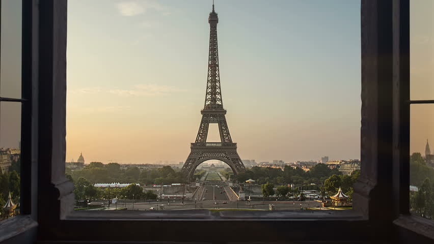 Unusual view of the eiffel tower seen from a window time lapse from night to day sunrise,new day birth over paris 4k