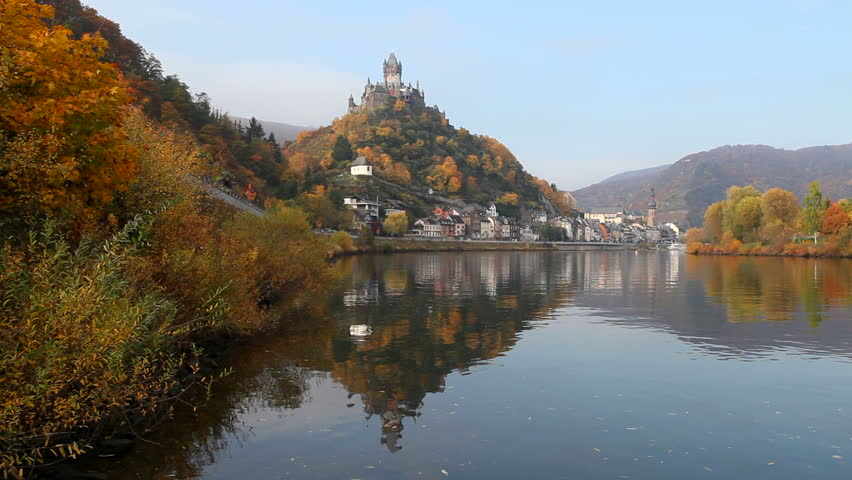 Panorama of the town Cochem on the river Moselle in Germany, with the Reichsburg castle on the hill. Beautiful autumn colors.